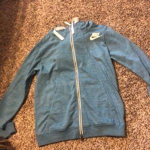 Blue sweatjacket with adjustable hoodie